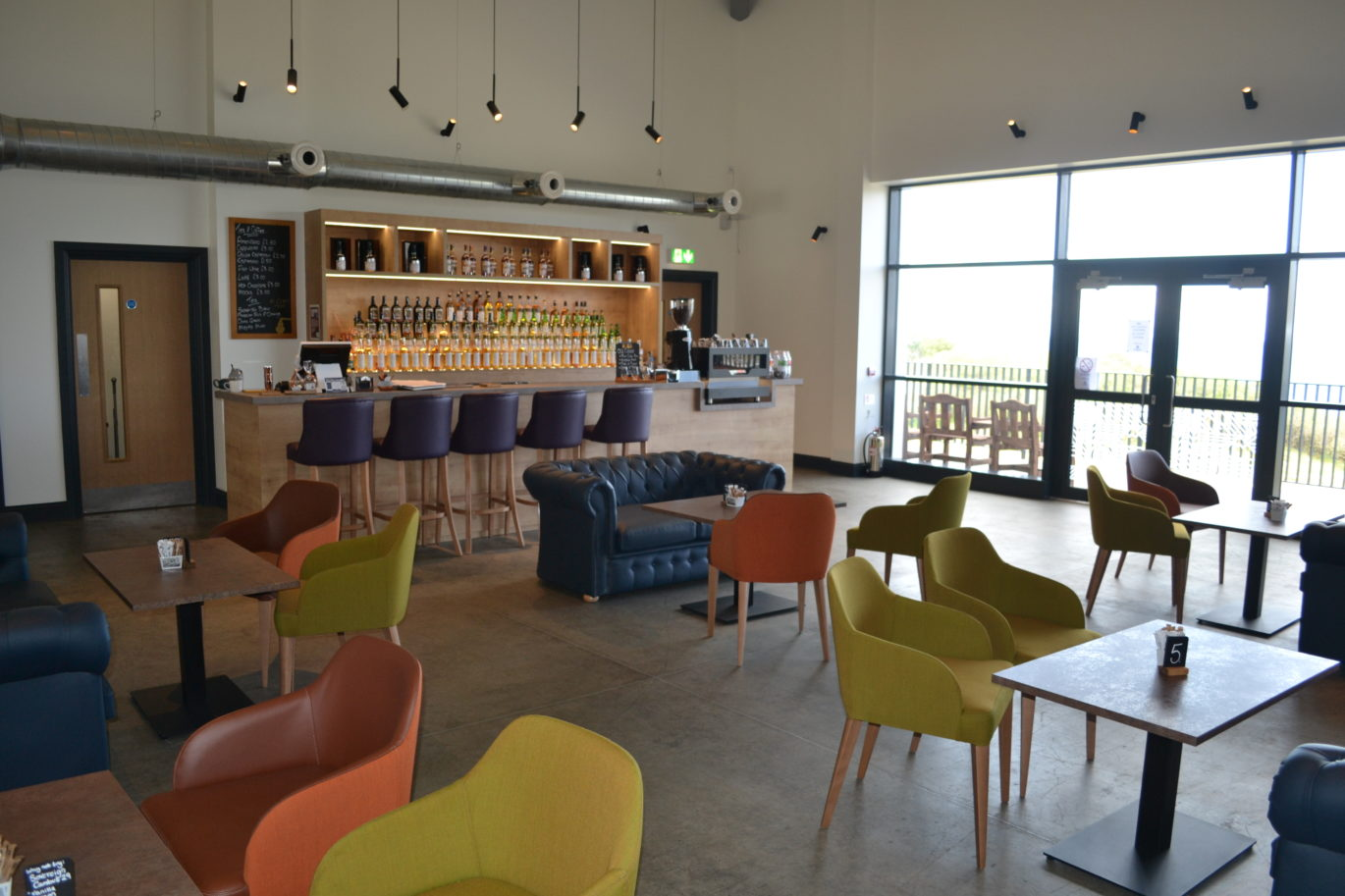 Ardnahoe Distillery and Visitor's Centre - Visitor Centre Bar, back gantry and bespoke retail and unitary